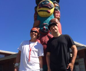 Tyler Jacobs and Bretten Hannam outside the Tsleil-Waututh Nation Community Centre